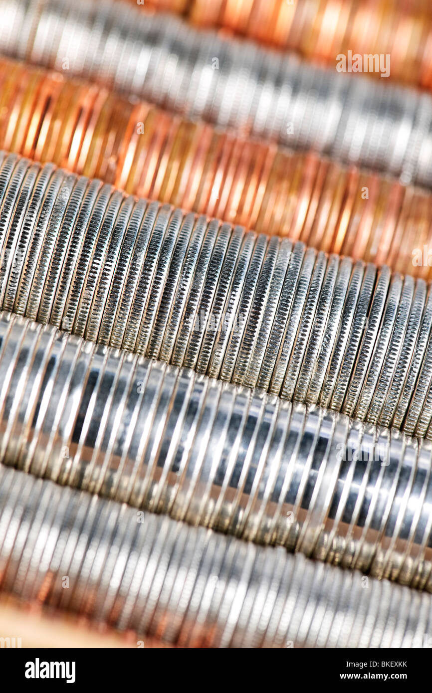 Background of penny nickel dime and quarter stacked coins - Stock Image