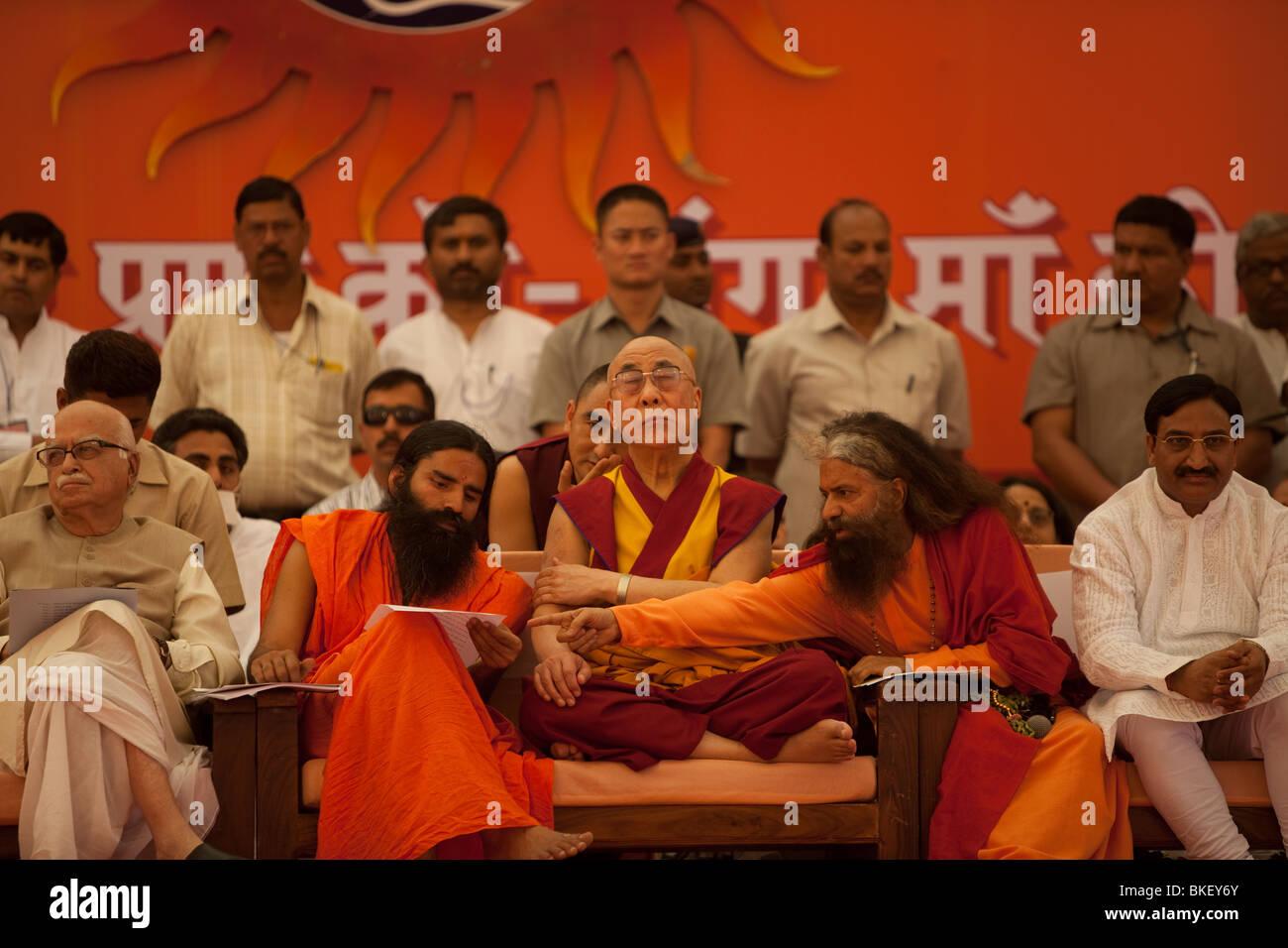 His Holiness the Dalai Lama in the presence of Parmarth Niketan guru Pujya Swamiji,  H.H. Swami Ramdevji, LK Advani, - Stock Image