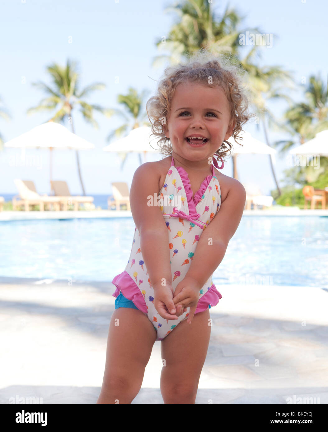 Happy toddler girl in bathing suit - Stock Image