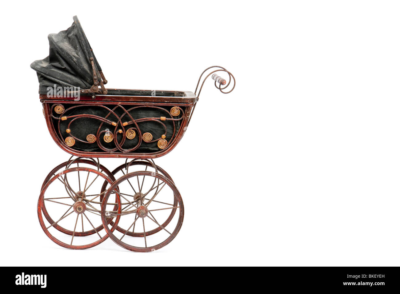 Rare antique Victorian wooden dolls pram with reversible hood, isolated on white background with empty space on - Stock Image