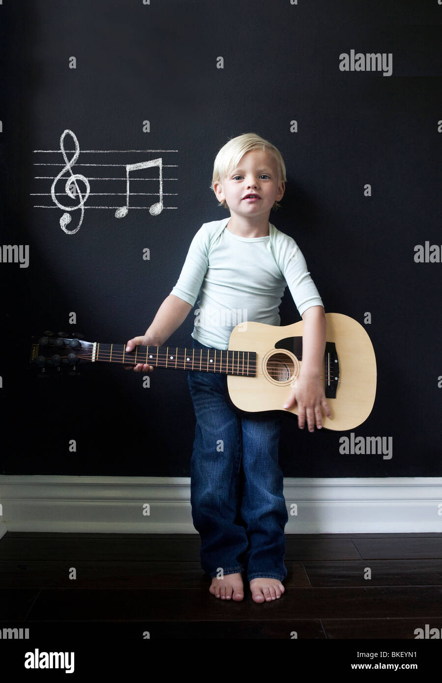 Young musician with acoustic guitar - Stock Image