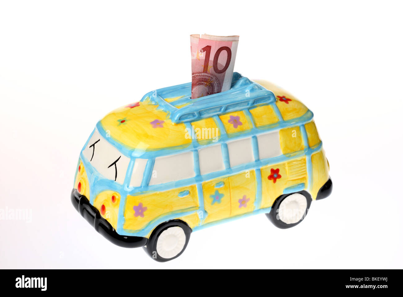 coin bank in form of a bus, ceramic - Stock Image