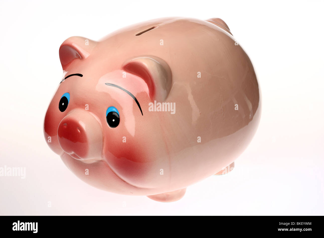 coin bank in form of a pig, ceramic - Stock Image