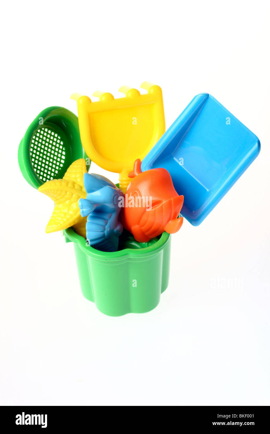 toys for kids, for the beach or sandbox. Bucket,rake, sand mold, sand spade. - Stock Image