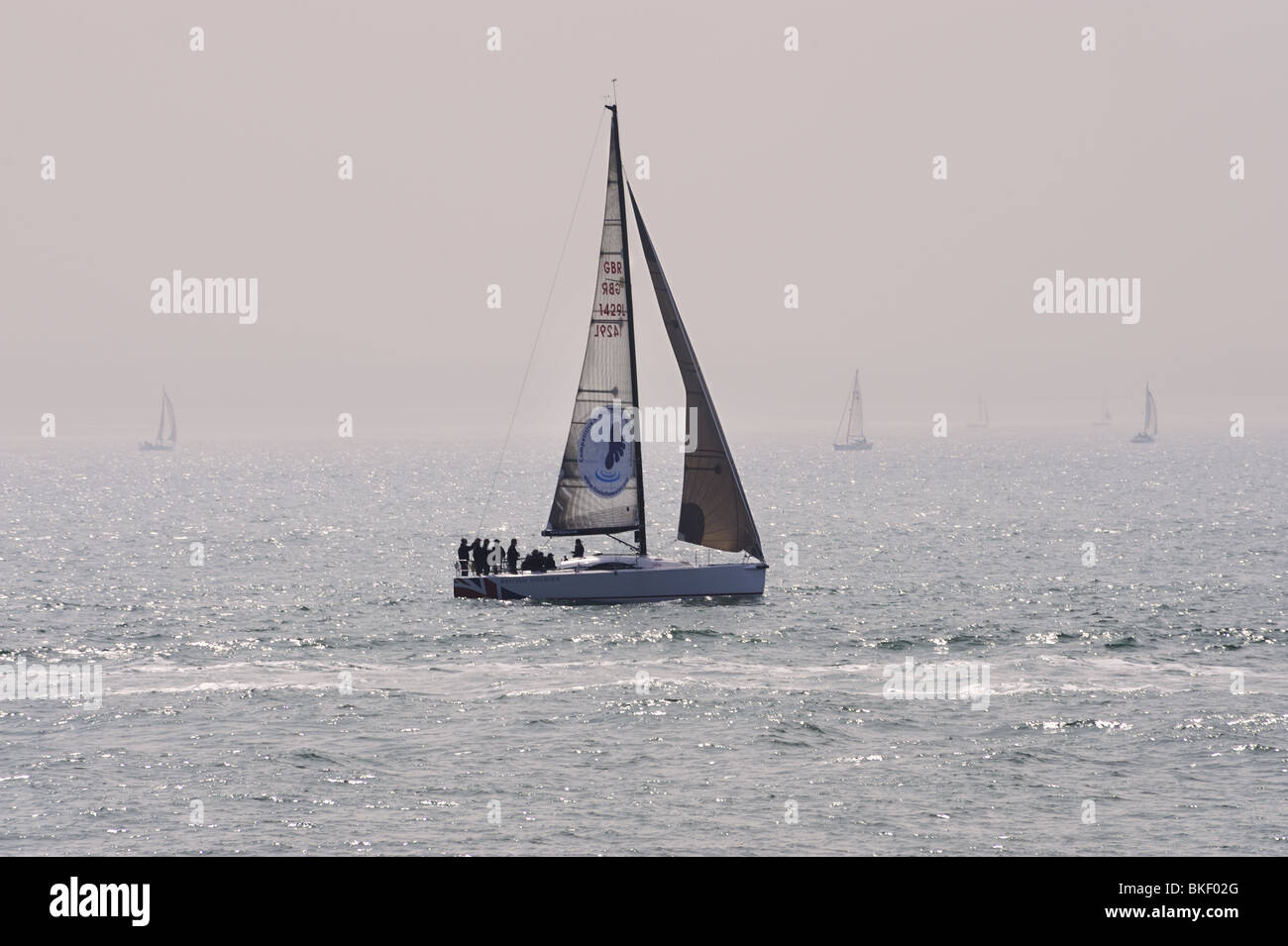 Yatch, 'British Soldier', sailing off Southsea, Hampshire, in misty sunlight - Stock Image