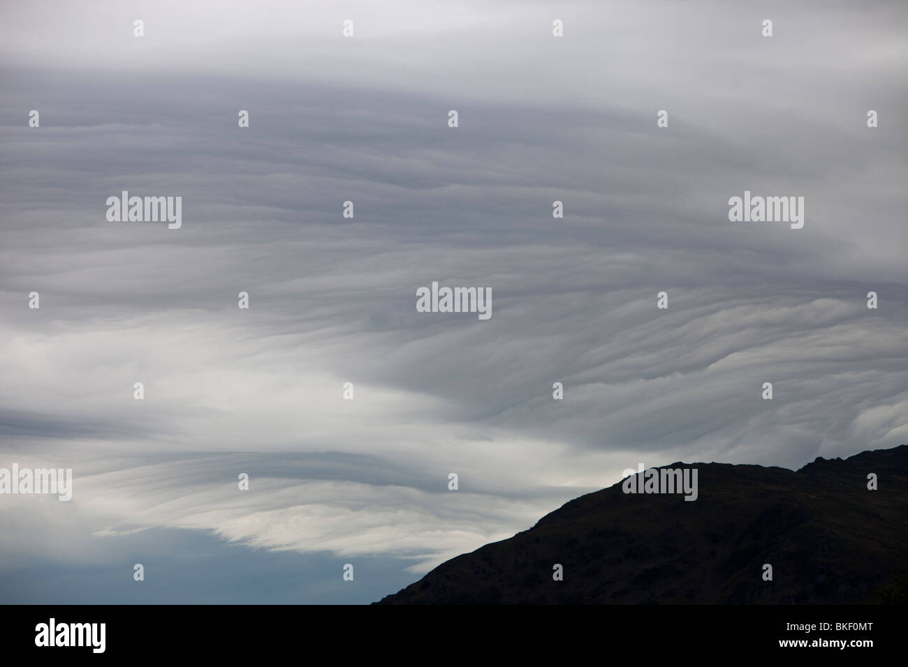 Patterns in cloud on an occluded front over the Lake District hills in Ambleside, Cumbria, UK - Stock Image