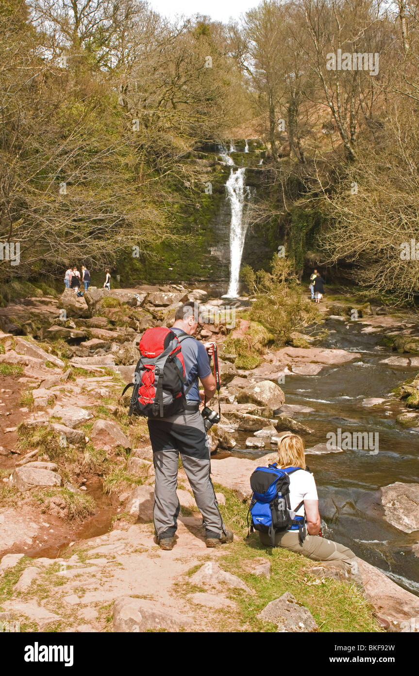 Walkers at the Blaen y Glyn Waterfall in the Brecon Beacons National Park Wales - Stock Image
