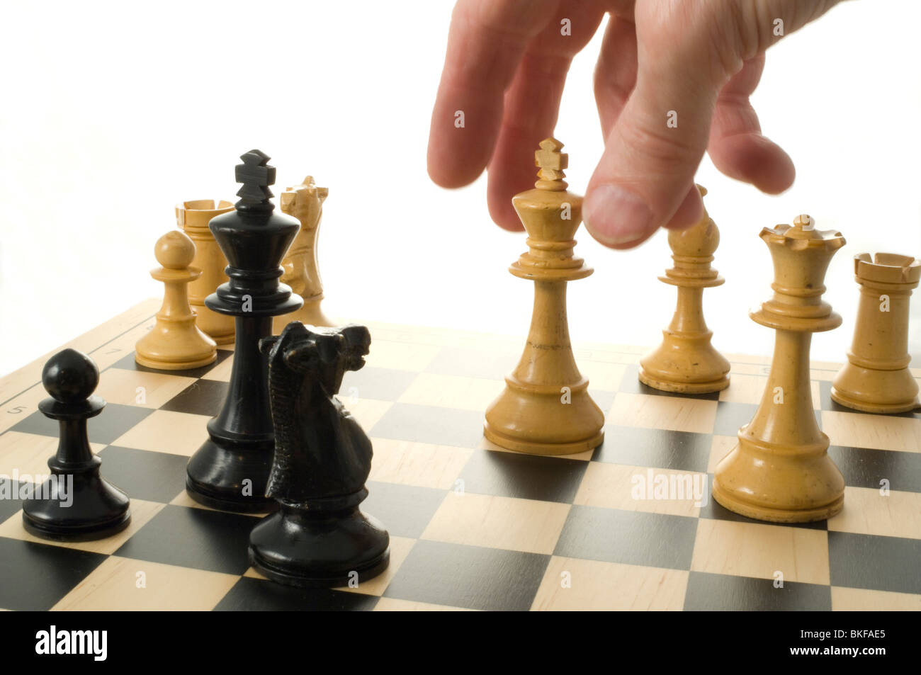 The great escape. Various chess pieces on chess board Stock Photo