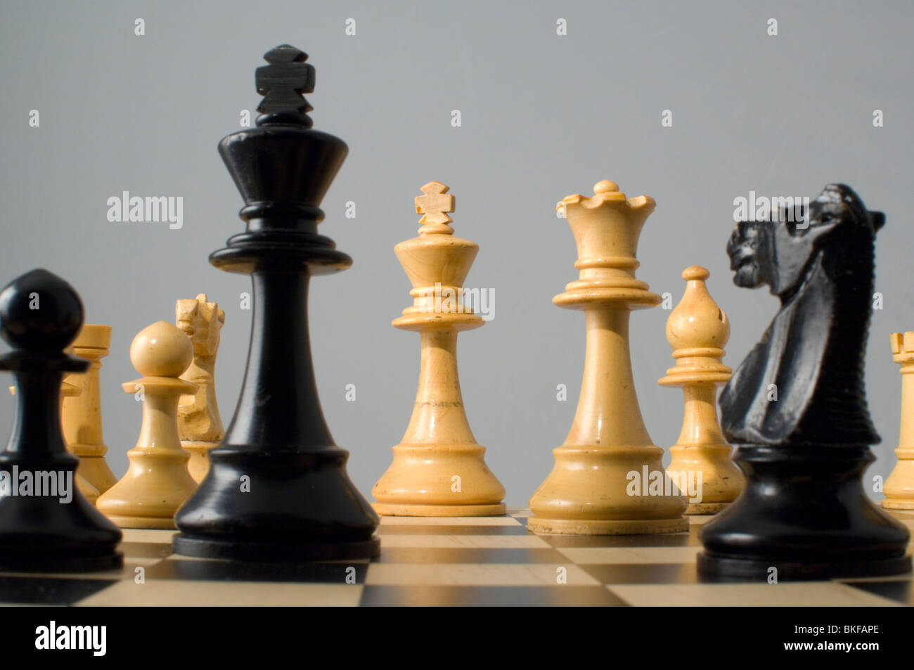 Chess. Checkmate. Various chess pieces on chess board Stock Photo