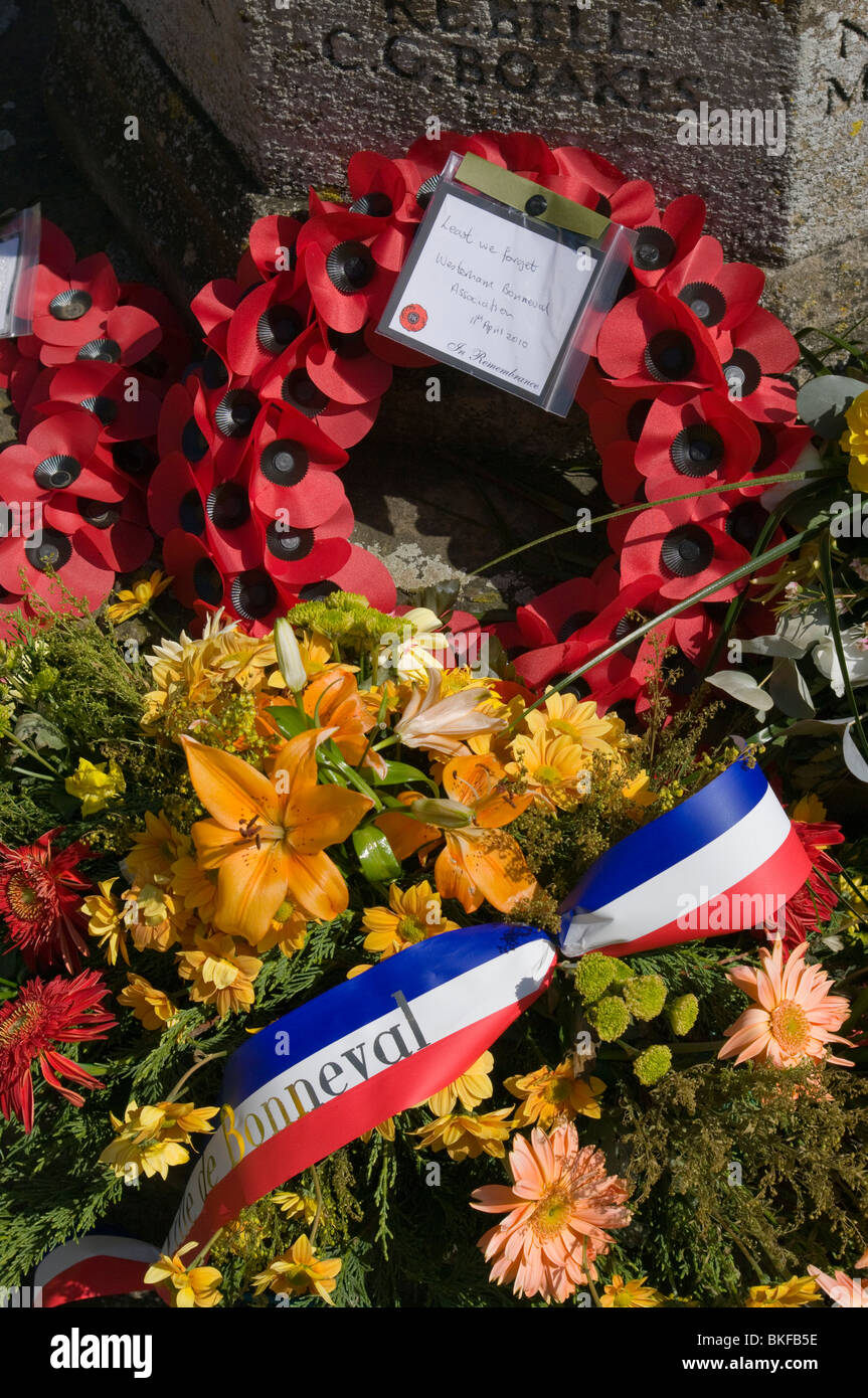 Flowers and Poppy Wreaths From The Bonneval Association at the Base Of A War Memorial At Westerham Kent England - Stock Image