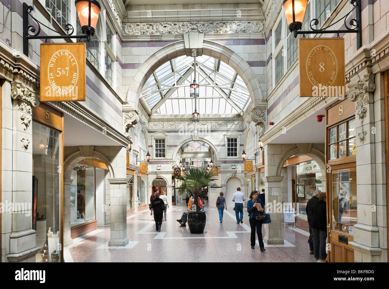 Shops on St Michael's Row in the Grosvenor Arcade Shopping Centre, Chester, Cheshire, England, UK - Stock Image