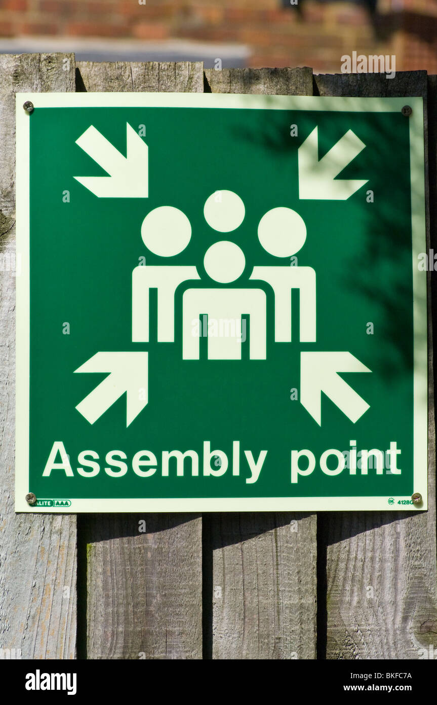 Green and White Assembly Point Sign - Stock Image