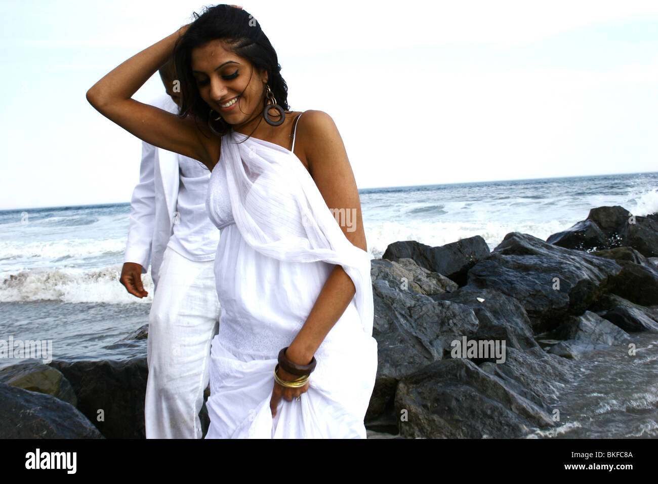 A Happy Looking South Asian American Desi Woman Pulling Back Her