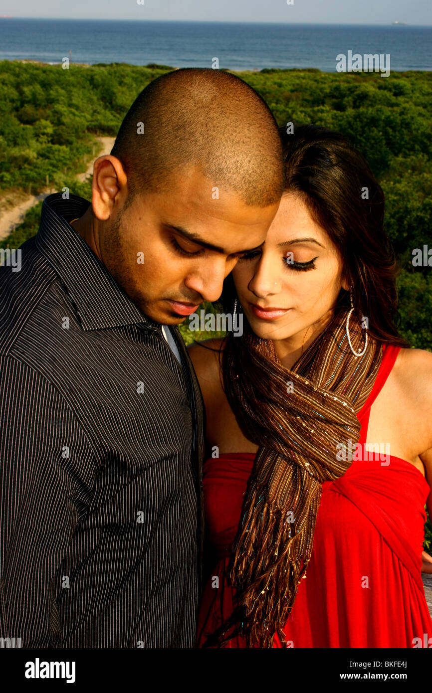 Portrait of a loving South Asian American couple during a tender moment. - Stock Image