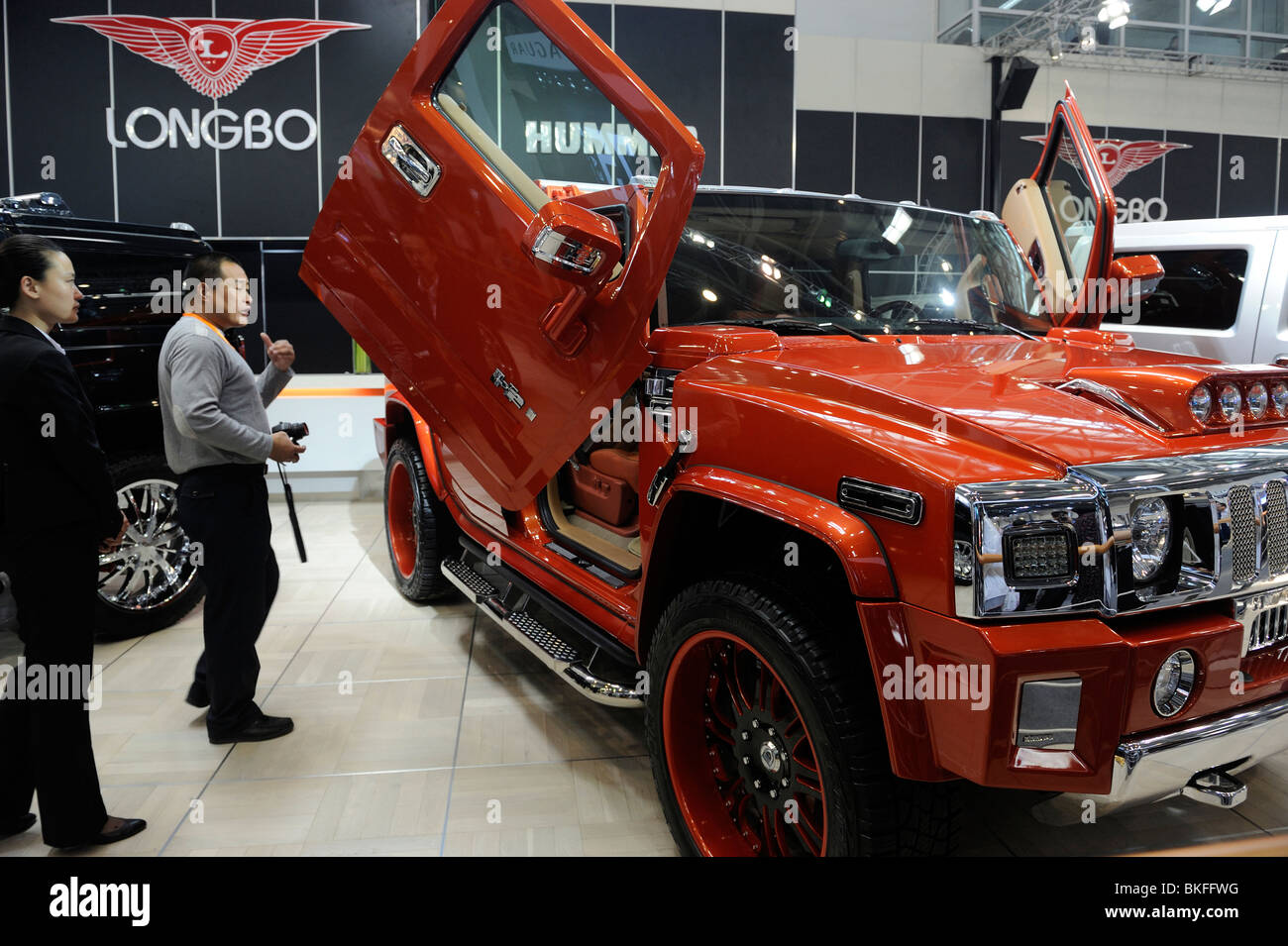 A Chinese man looks at a Longbo customized Hummer H2 at the Beiijng Auto Show. 23-Apr-2010 - Stock Image