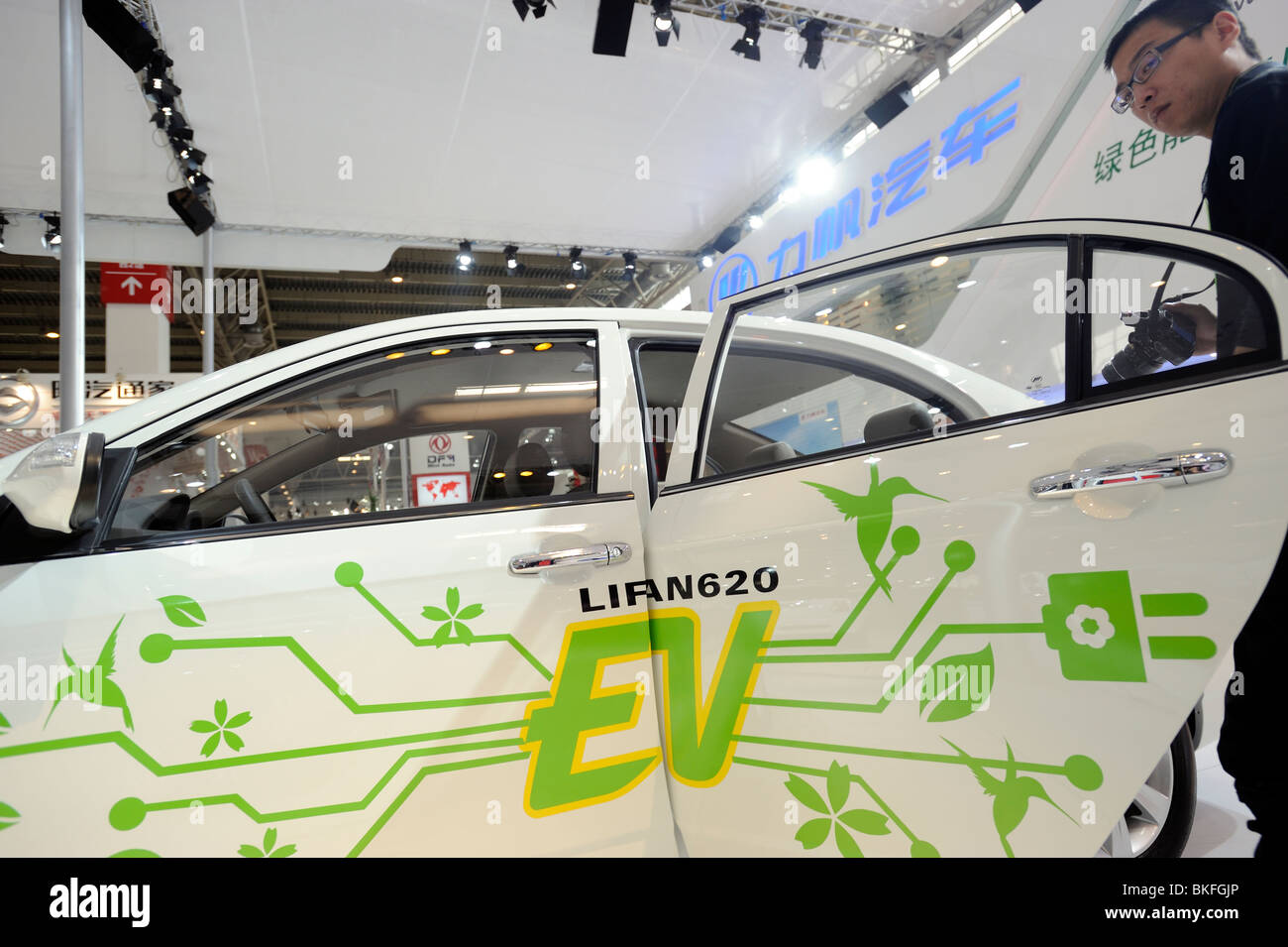A man looks at a Lifan 620 EV at the Beijing Auto Show in Beijing, China. 24-Apr-2010 - Stock Image