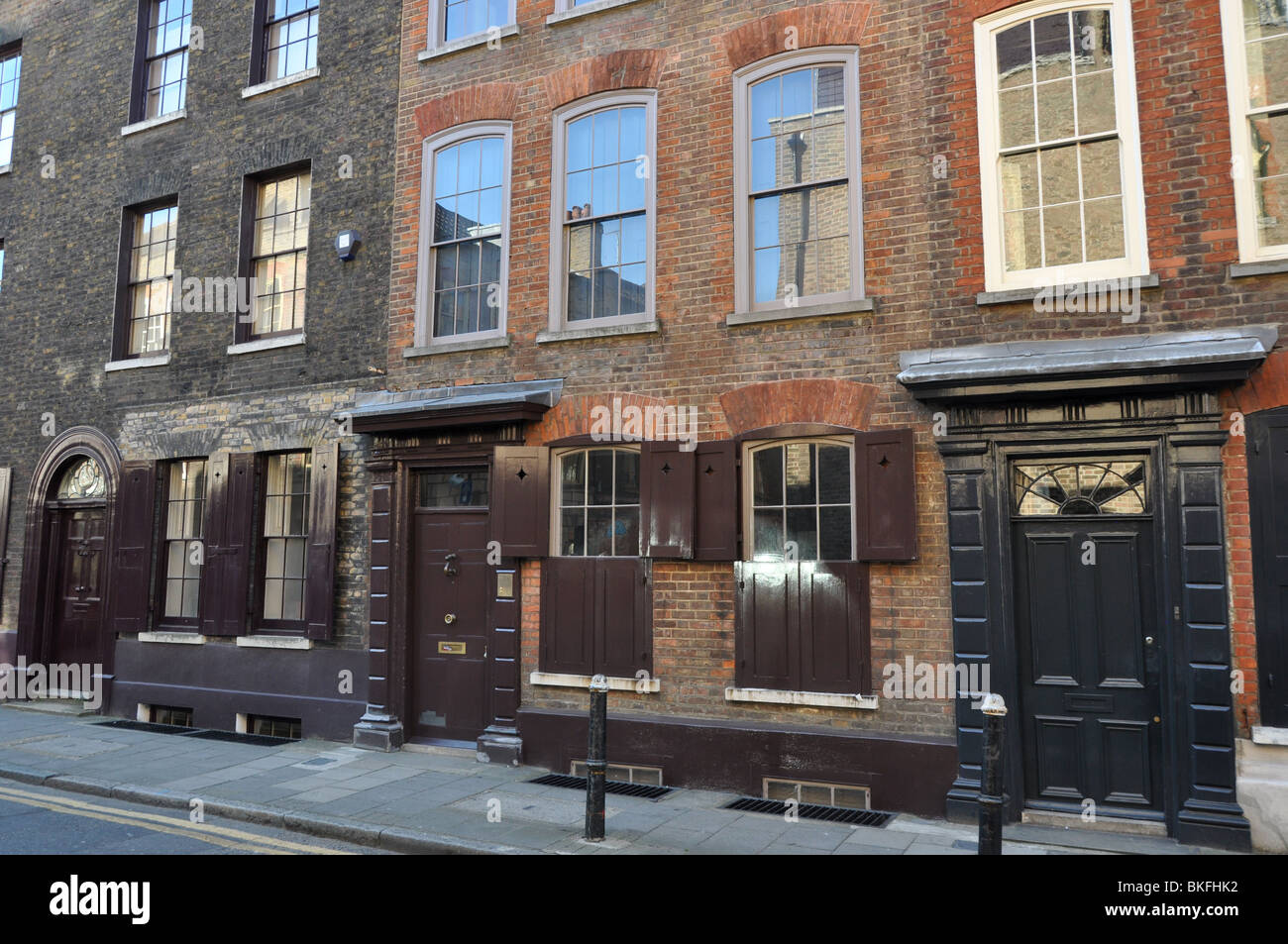 A terrace of charming period houses at Spitalfields London UK - Stock Image
