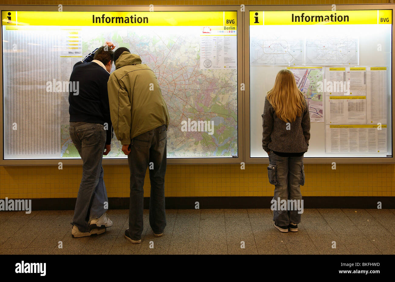 People standing in front of city and underground map, Berlin, Germany Stock Photo