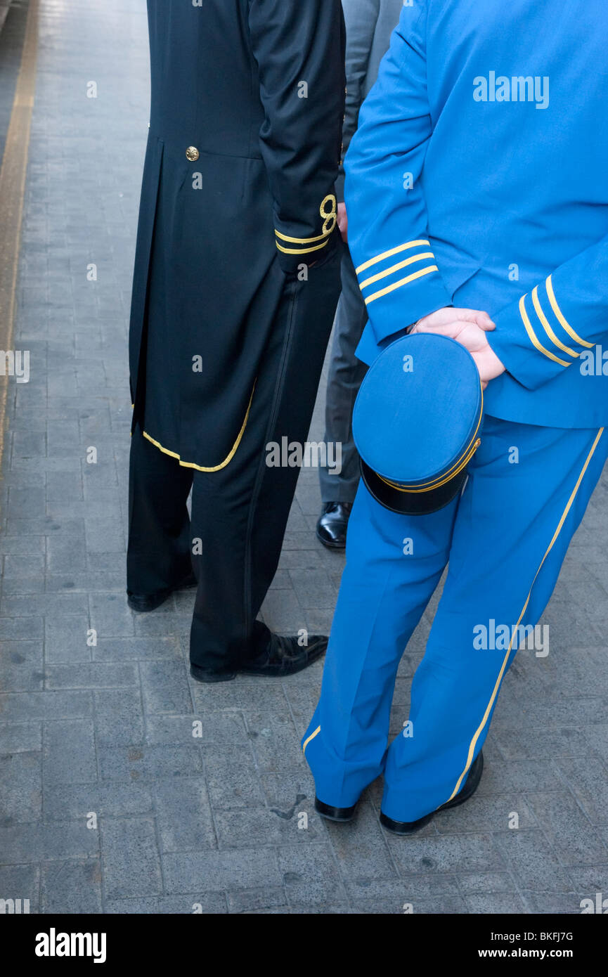 Railway staff from Orient Express on platform at Venice Railway Station in Italy - Stock Image