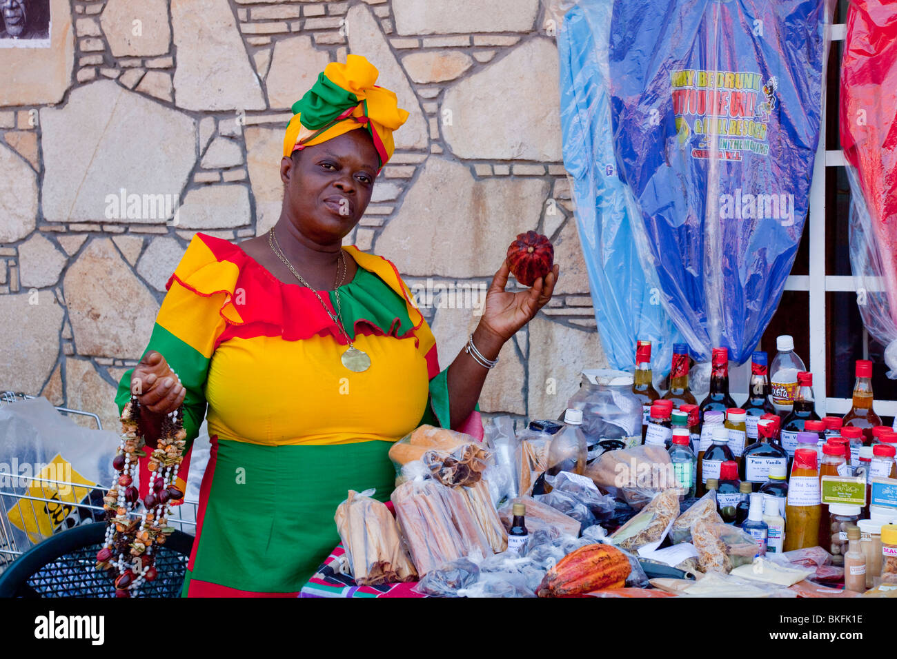 A lady in ethnic dress at a street market kiosk in St. George's, Grenada, West Indies. Stock Photo