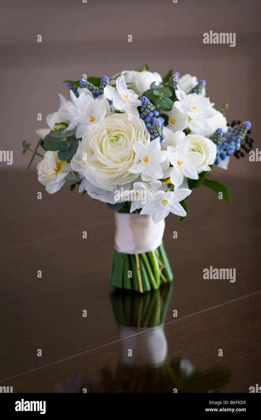 bouquet or posey of spring flowers including ranunculus, daffodil, muscari, hedera - Stock Image