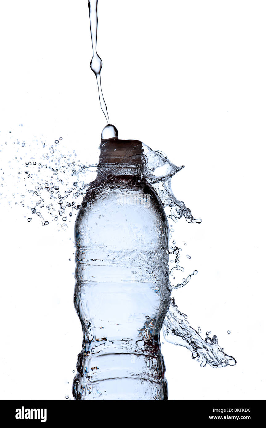 water splashing on a water bottle - Stock Image