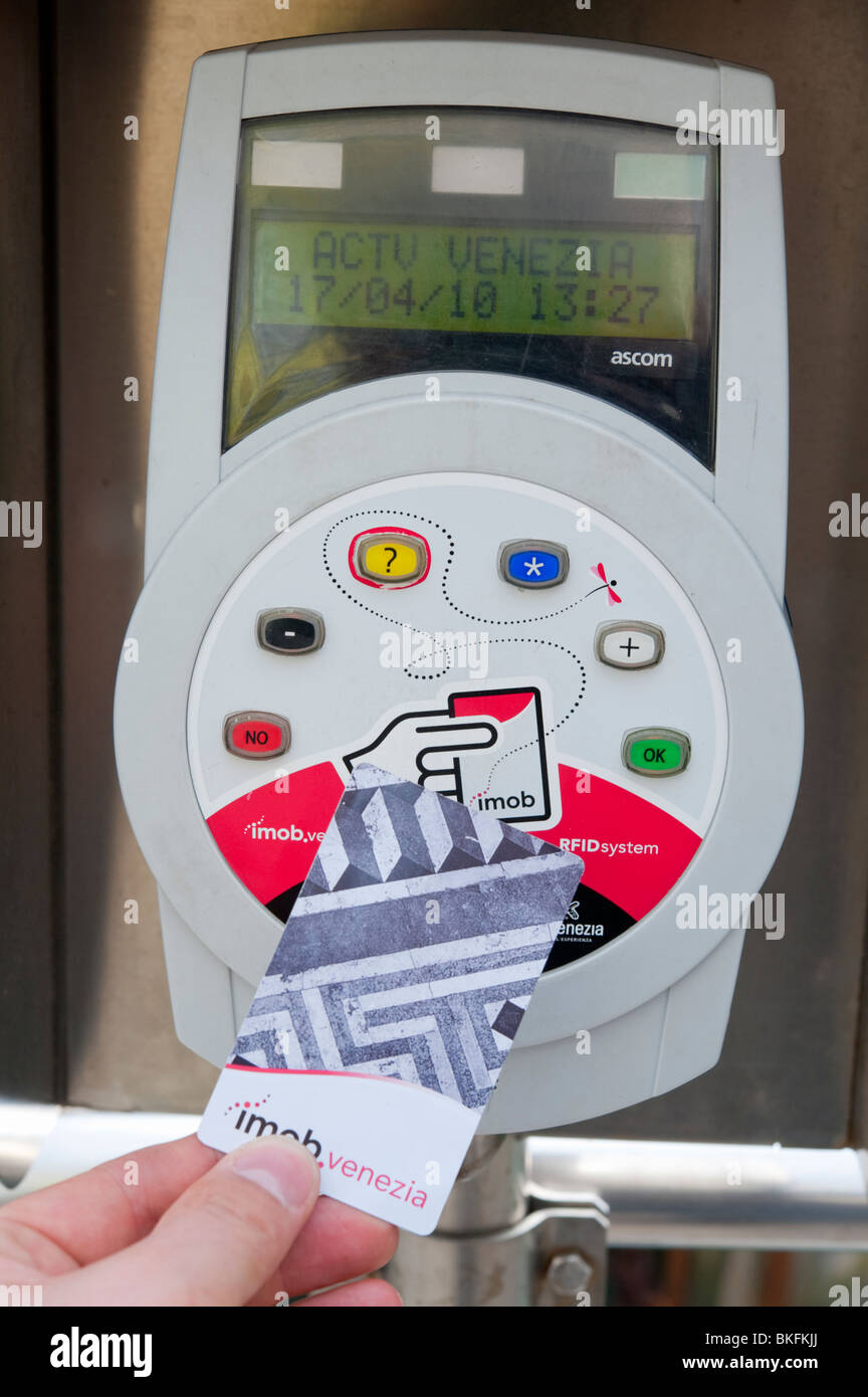 Electronic ticket machine using RFID contact less magnetic card at Vaporetto or water bus stop on Grand Canal in - Stock Image