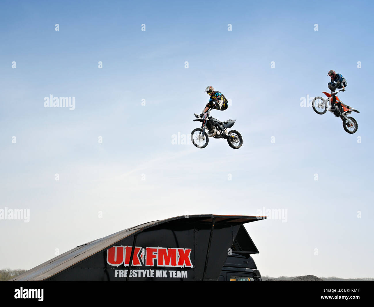 Freestyle motorbikes in the air. - Stock Image