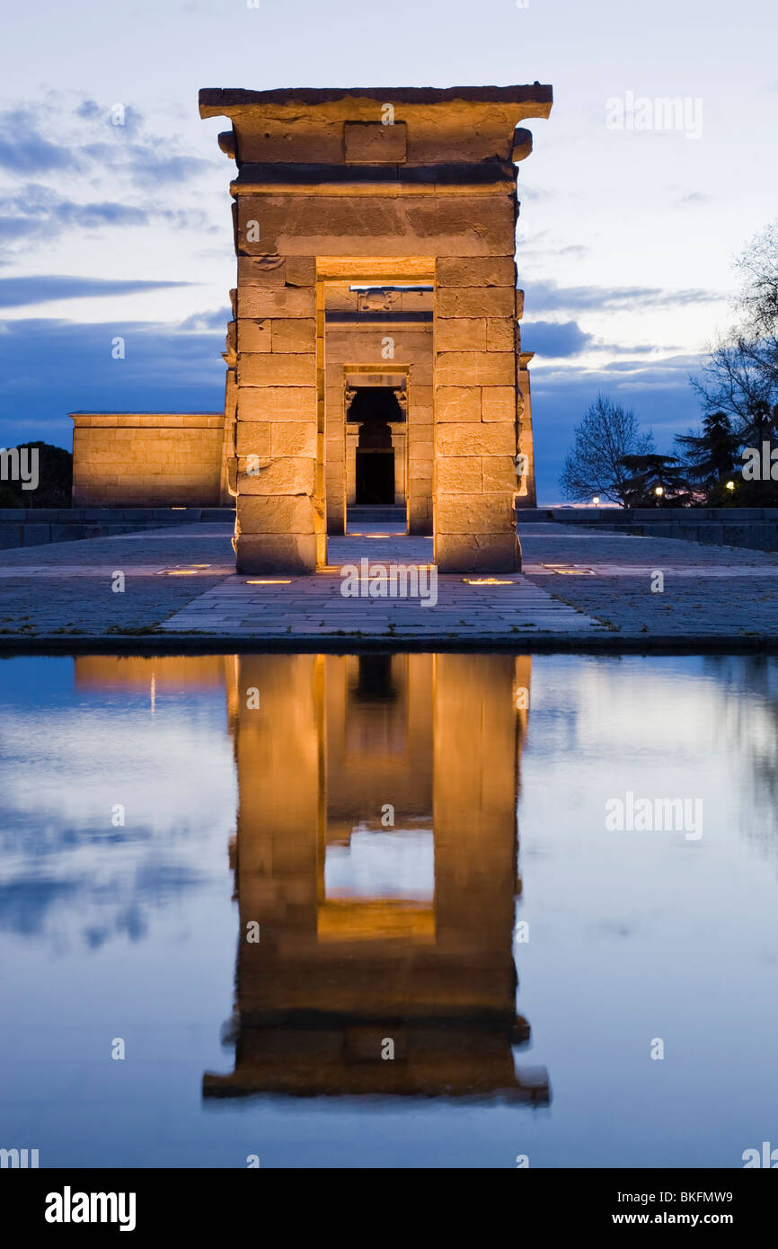 Main gate of egyptian temple at night with a water reflection - Stock Image