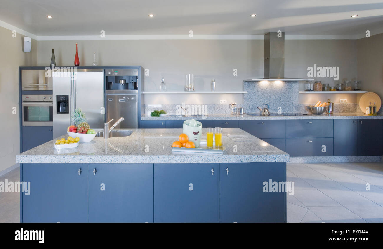 Blue island unit with pale gray granite worktop in large modern ...