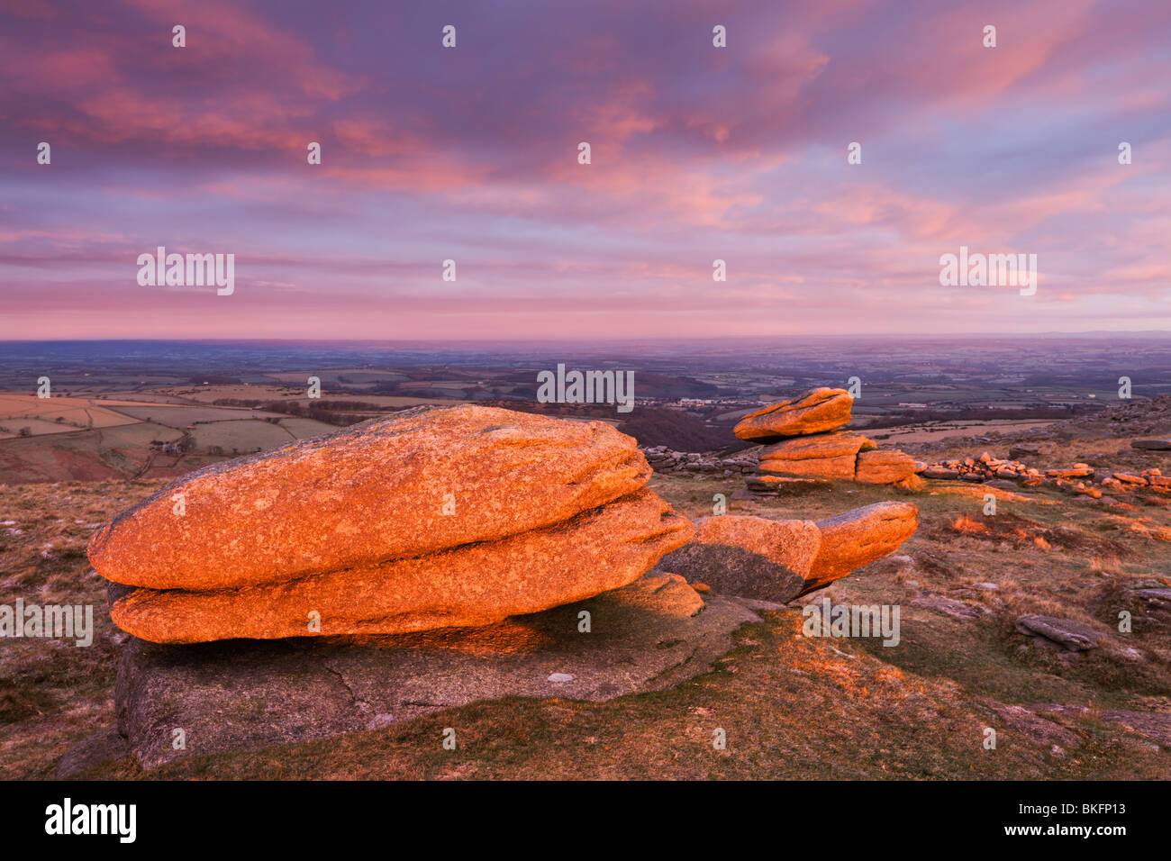 Logan stones bathed in first light of a winter morning, Belstone Tor, Dartmoor National Park, Devon, England. - Stock Image