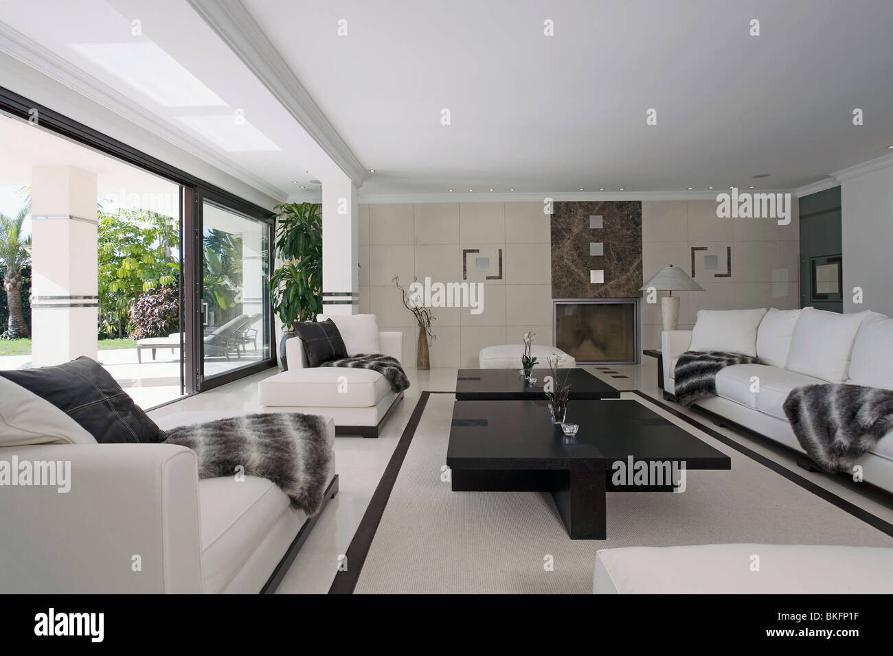 Black+white throws on white sofas in large modern white ...