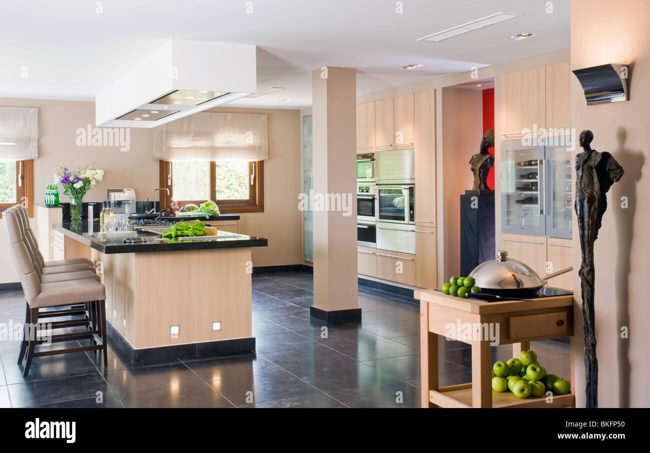 Black Granite Flooring In Large Modern Kitchen With Breakfast Bar On Stock Photo Alamy