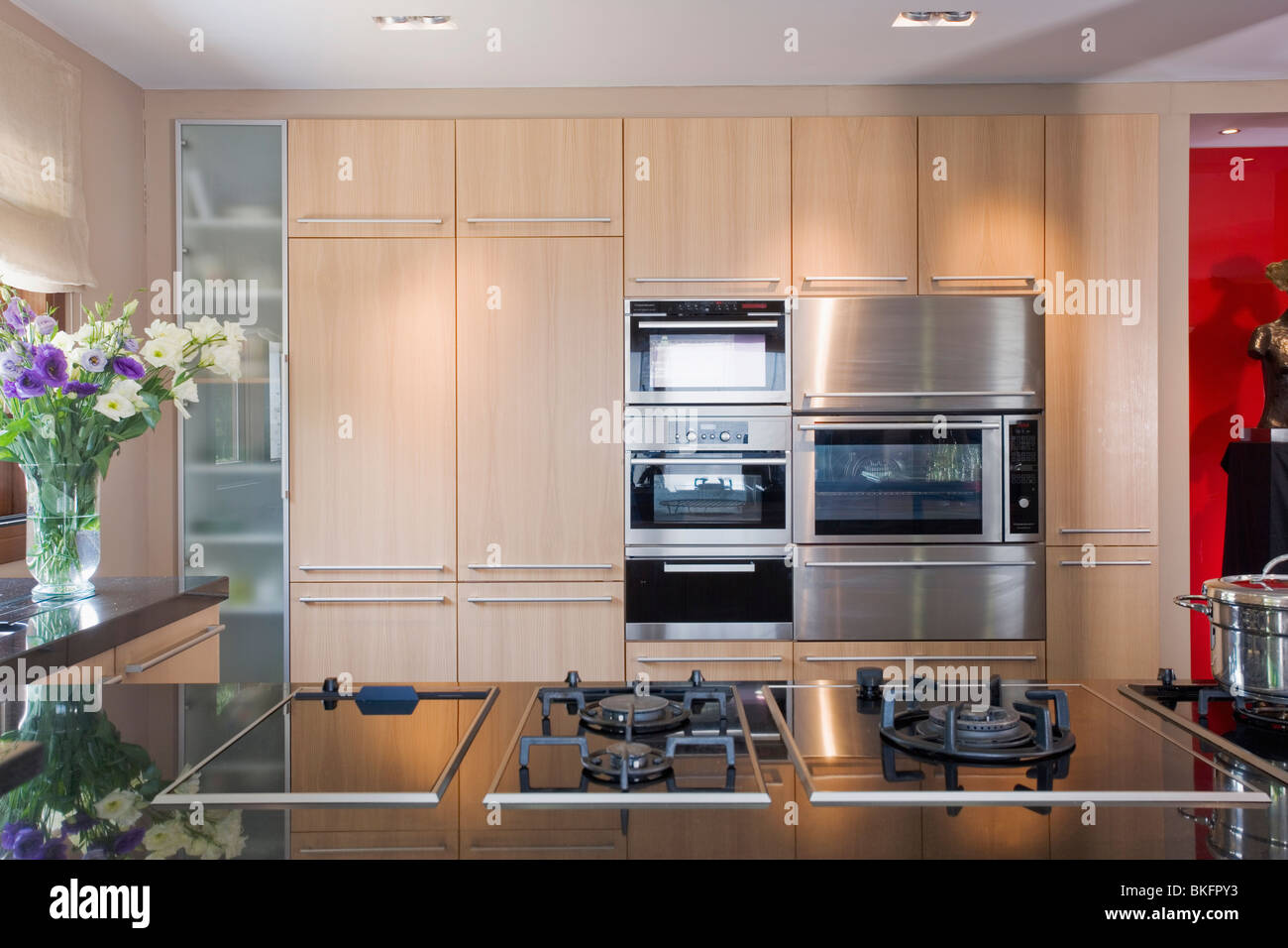Gas hobs in fitted unit in modern kitchen with double ovens in