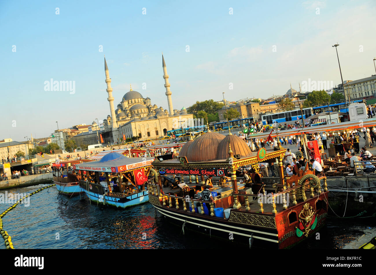Port of Istambul with restaurant boats - Stock Image