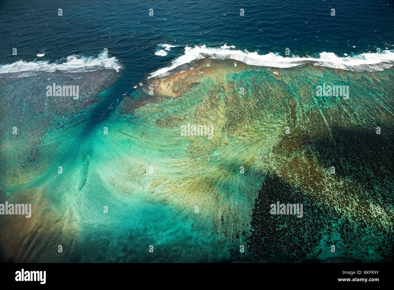 Aerial view of coral reef and ocean - Stock Image