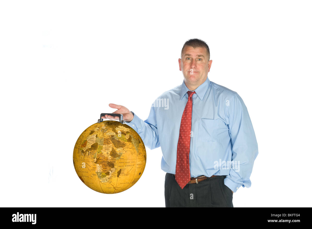 An international businessman hodls his world globe briefcase. - Stock Image