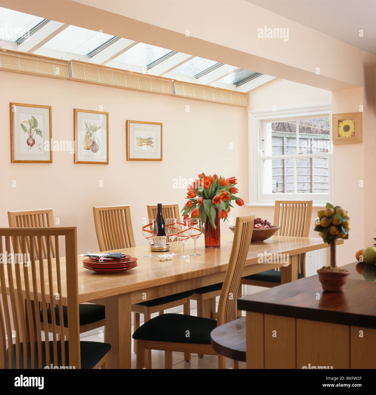 Picture of: Wooden Table And Tall Back Chairs In Modern White Dining Room Stock Photo Alamy