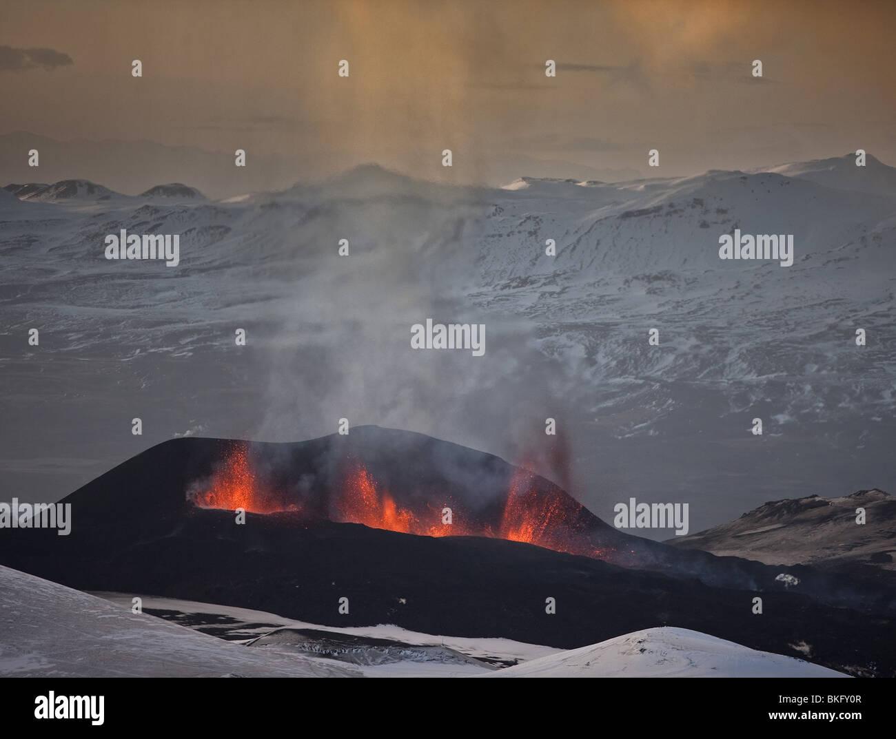 Lava fountains during volcano eruption at Fimmvorduhals, a ridge between Eyjafjallajokull glacier, and Myrdalsjokull, - Stock Image