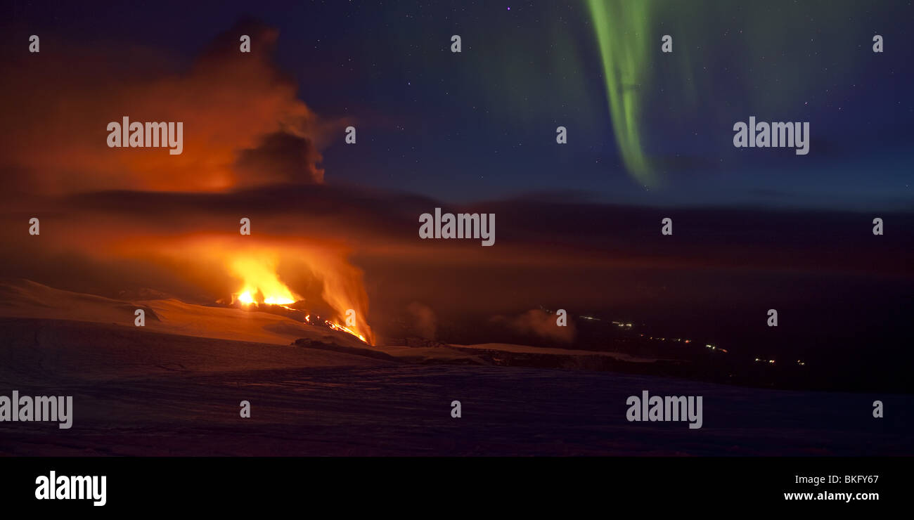 Auroras with volcano eruption in Iceland at Fimmvorduhals, a ridge between Eyjafjallajokull glacier and Myrdalsjokull - Stock Image