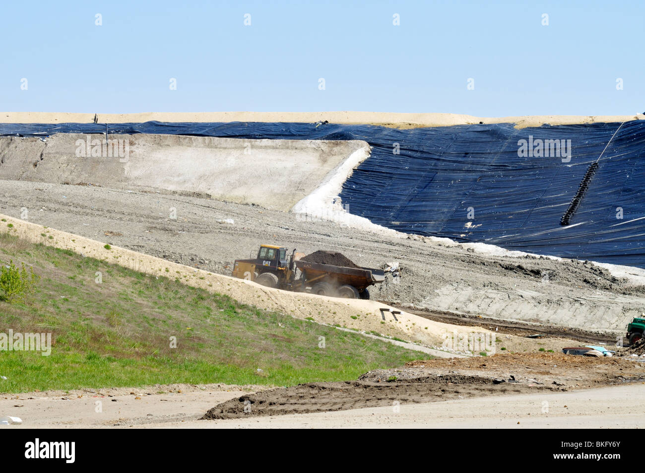 Closed full area of a waste management landfill being capped in Bourne, Cape Cod Massachusetts USA - Stock Image