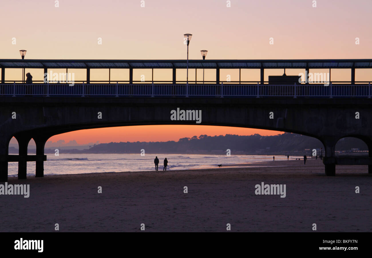 Sunset at Bournemouth Pier with couple walking Stock Photo