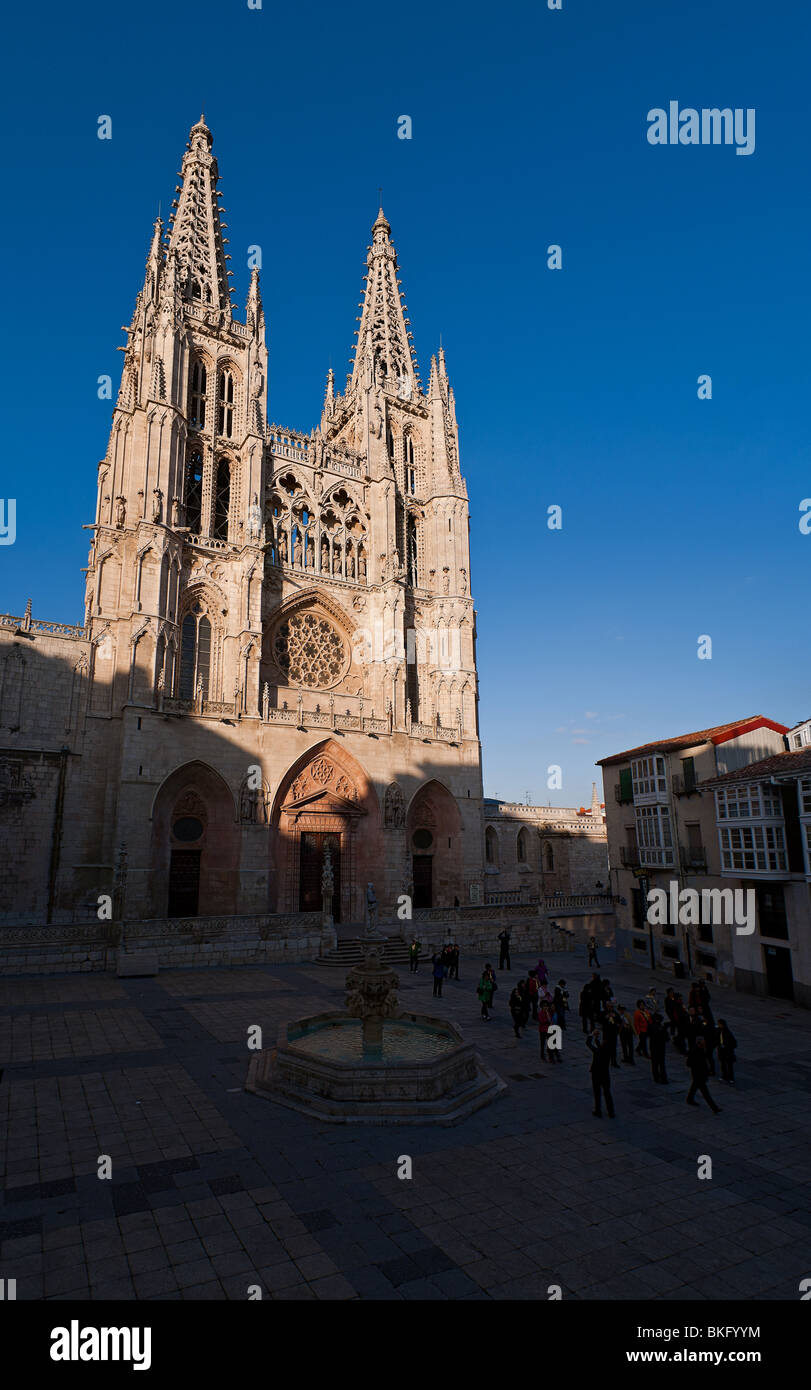 A Japanese tourist group go out of the Burgos cathedral - Stock Image