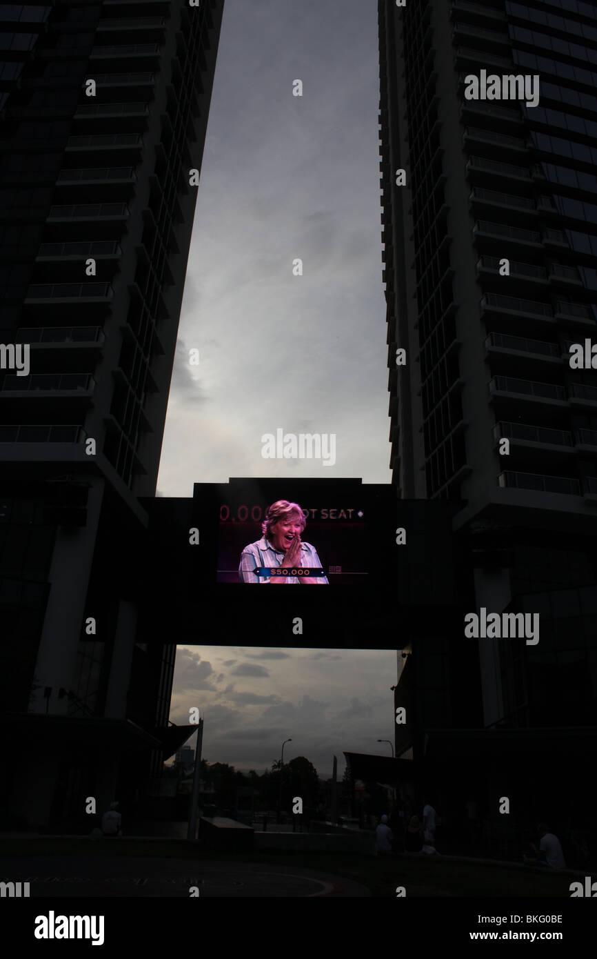 A large plasma screen between two buildings in Brisbane, Australia. - Stock Image