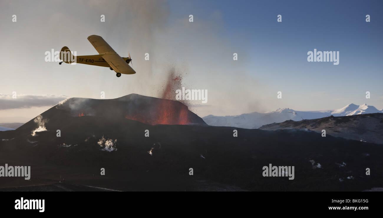 Cessna plane-volcano eruption in Iceland at Fimmvorduhals, a ridge between Eyjafjallajokull glacier and Myrdalsjokull - Stock Image