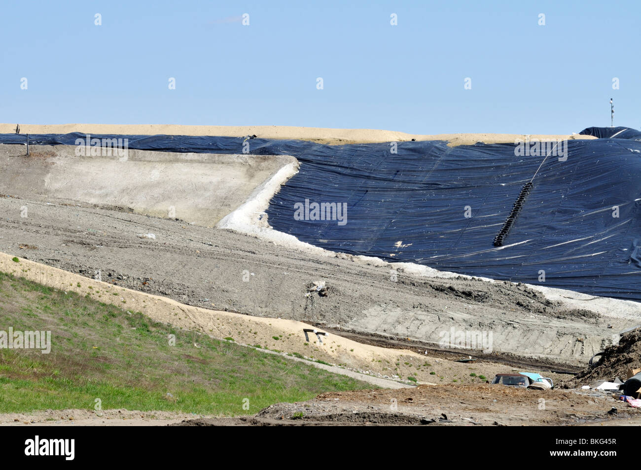 Landfill dump being capped with black plastic for reclamation in Bourne, Cape Cod, Massachusetts USA - Stock Image