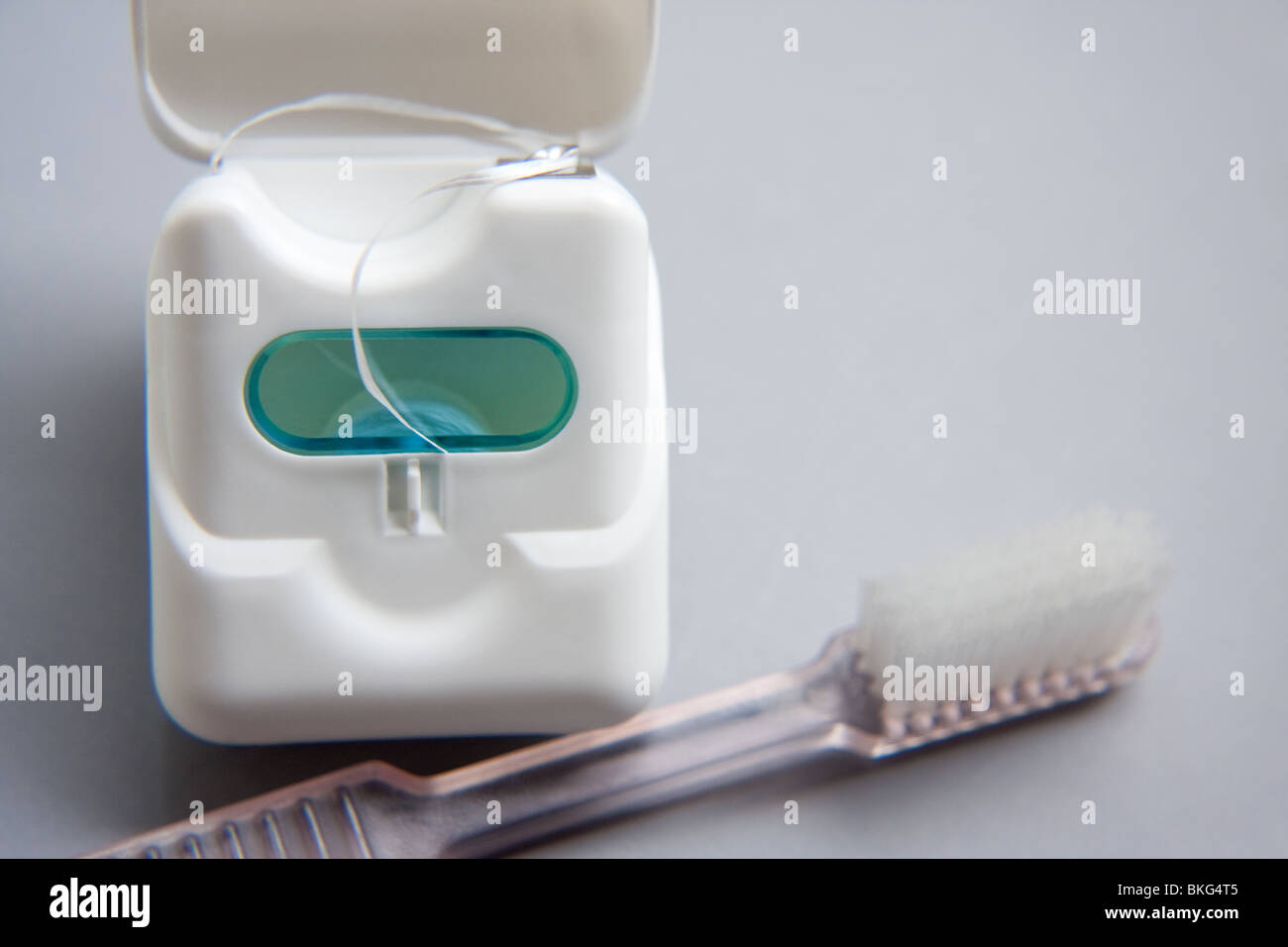 Dental floss with toothbrush - Stock Image