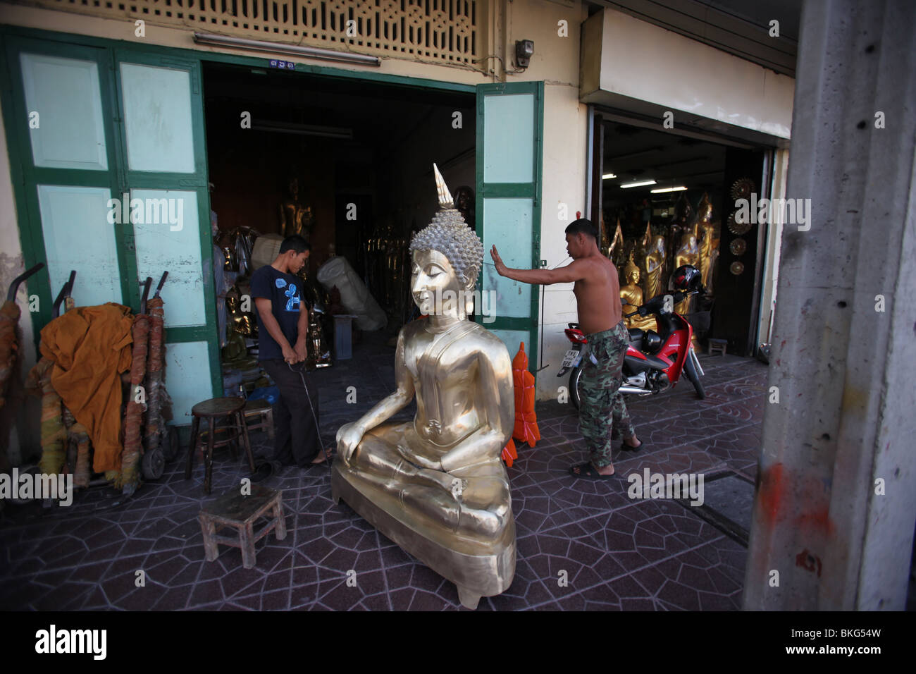 Buddhism for sale - A commercial shop in Bangkok, Thailand. - Stock Image