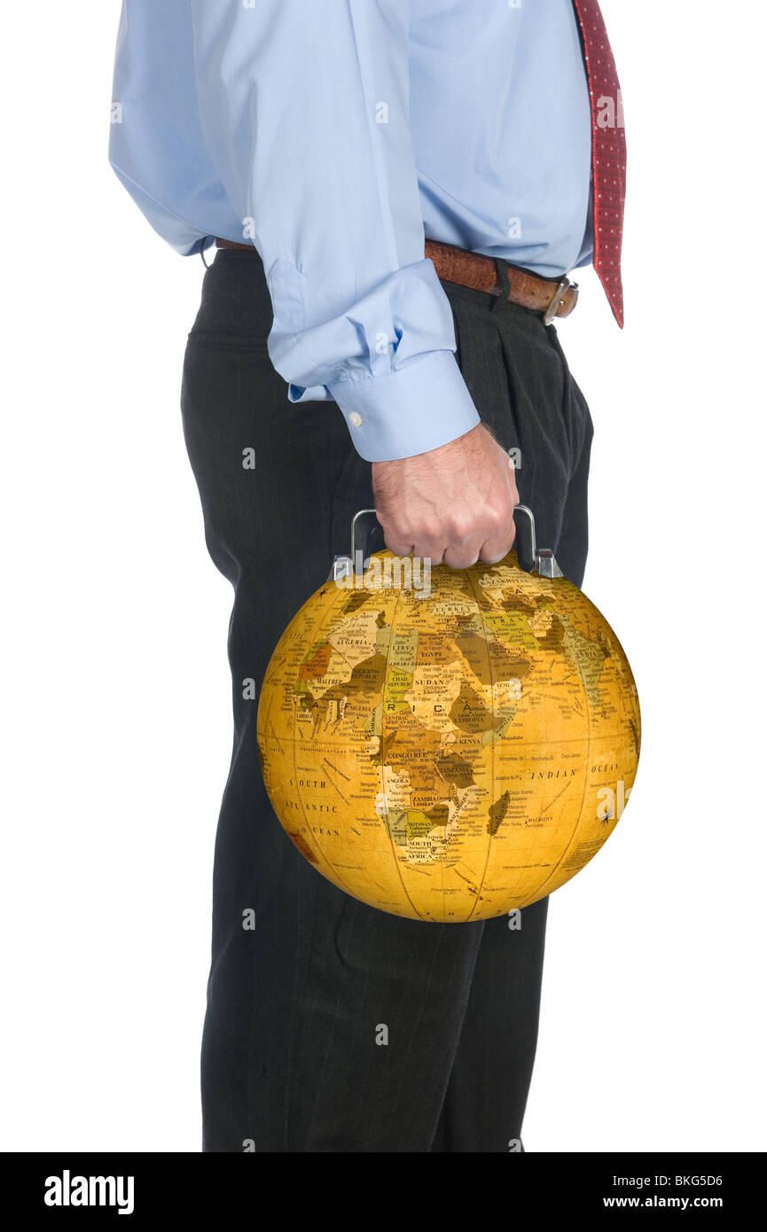 An international businessman carrying his world globe briefcase. - Stock Image