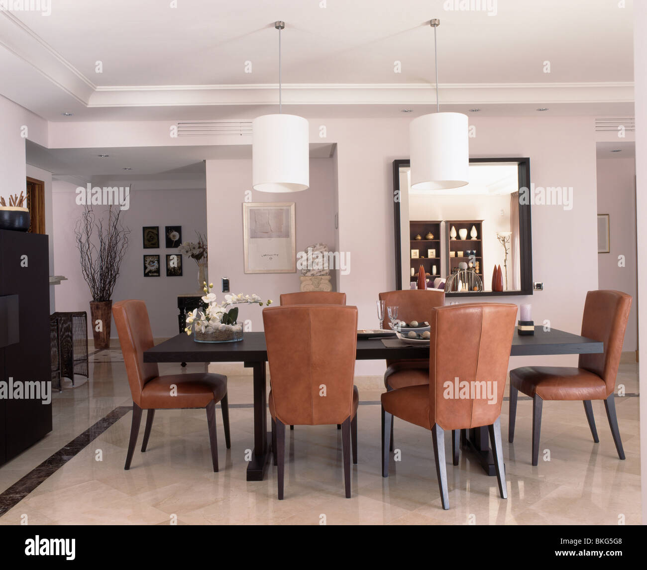 Upholstered tan leather chairs at table in modern white dining room ...